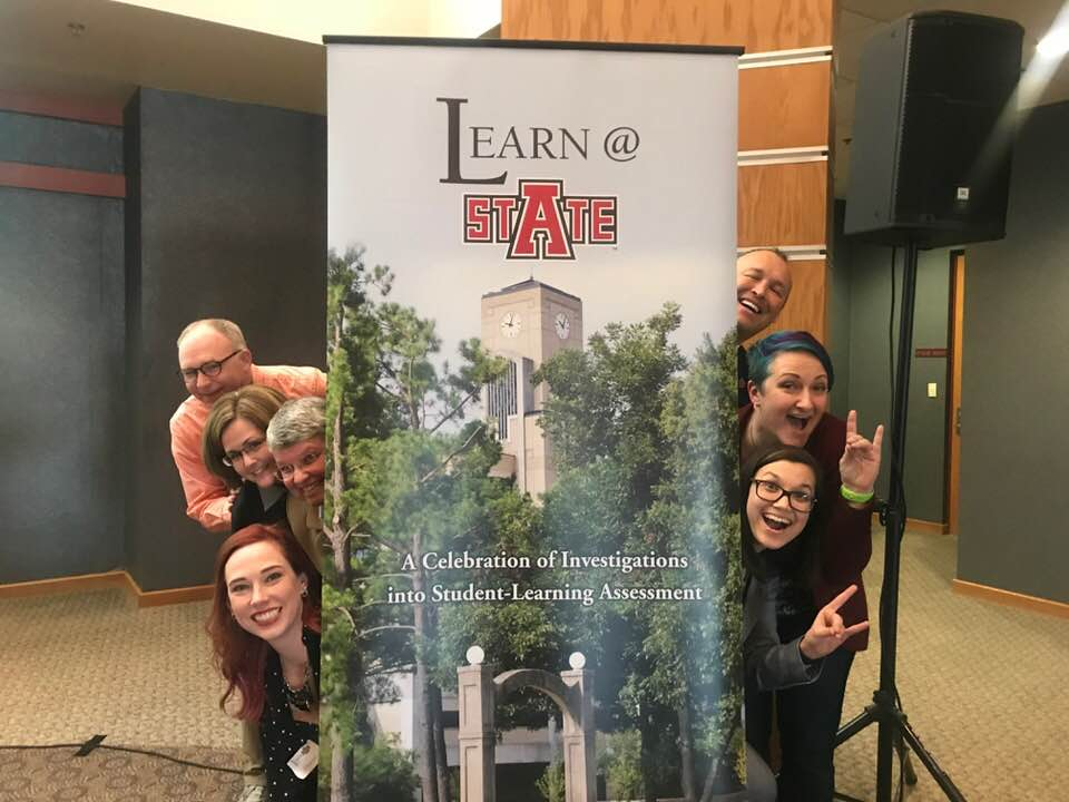 Image is Lisa Bohn and colleagues at Arkansas State University, at the Learn@StAte assessment conference