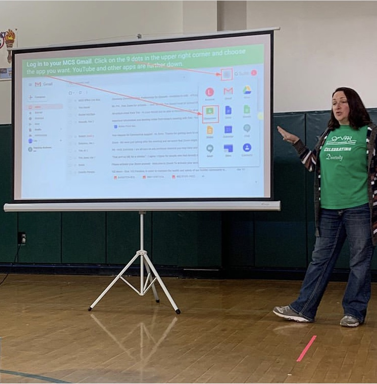 Image is Lisa Bohn leading a MCS faculty training for Google Classroom in mid-March